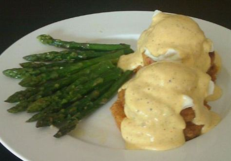 Chesapeake Bay Style Eggs Benedict and Asparagus - The base is a Fried Green Tomato topped with a Chesapeake Bay Crab Cake