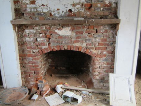 Fireplace on the living quarters side of the Summer Kitchen