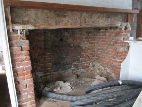 Fireplace on the kitchen side of the Summer Kitchen