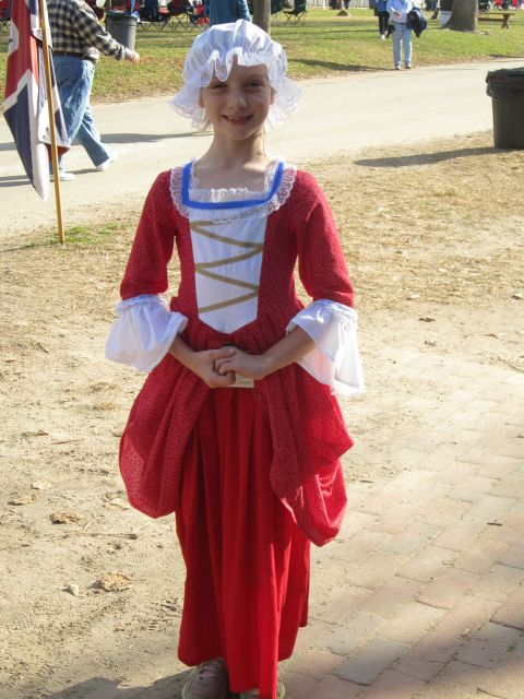 Meet Elody. This is not one of the reenactors, but a guest. Children can rent costumes and enjoy the life of a colonial child for the day!