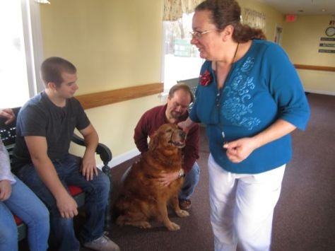 Hurley greets the staff