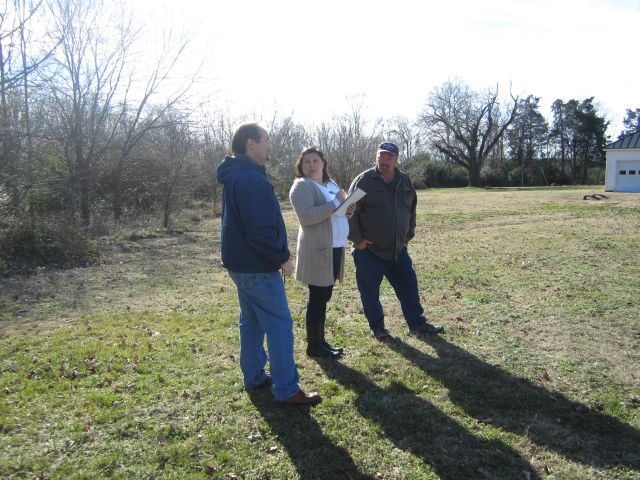 Brett, Linda and Rick planning the driveway and parking area