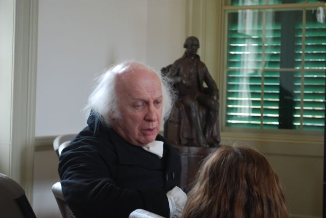 Mr. Madison holding a conversation with a young girl