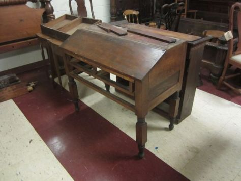 This is a primitive Plantation Desk.